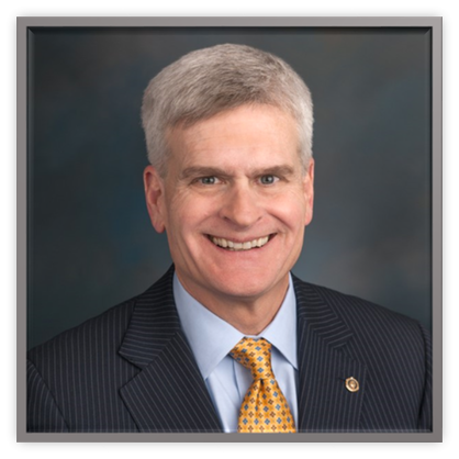 Picture of Congressman Bill Cassidy in a dark suit, blue shirt and gold tie
