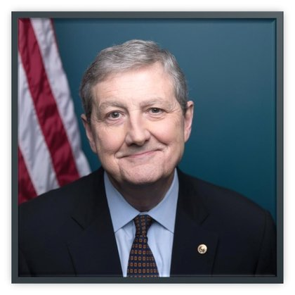 Picture of Congressman John Kennedy in a dark suit, light blue shirt and checker dark red tie